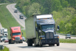 ist1_6019629-semi-trucks-on-the-interstate